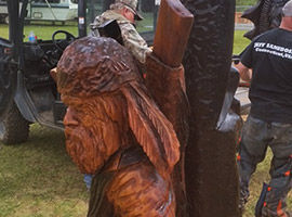 Hunter and Trapper Chainsaw Sculpture