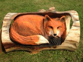 Fox in Log Chainsaw Carving